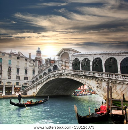 Venice,  Rialto bridge and with gondola on Grand Canal, Italy - stock photo