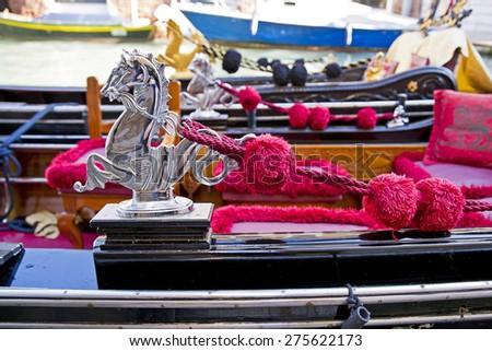 Venice - Rich decorations of the deck of a venetian gondola - stock photo