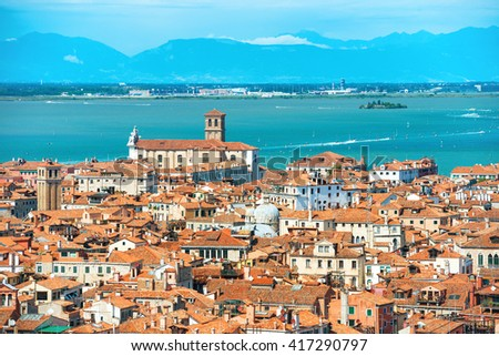 Venice roofs from above. Aerial view of houses, sea and palaces from San Marco tower - stock photo