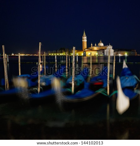 Venice, San Giorgio Maggiore church Long exposure By Night. Blurred motion Gondolas due to Grand Canal sea movement. - stock photo