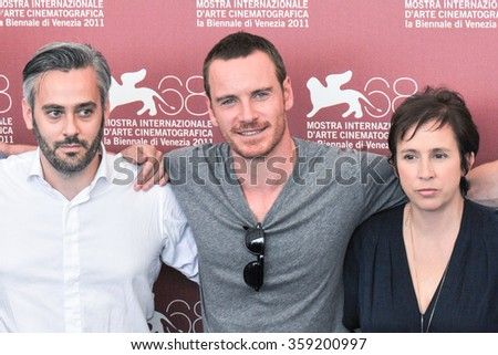 VENICE - SEPTEMBER 4: Actors Emile Sherman, Michael Fassbender and Abi Morgan at photocall during the 68th Venice Film Festival at Palazzo del Cinema in Venice, September 4, 2011 in Venice, Italy. - stock photo