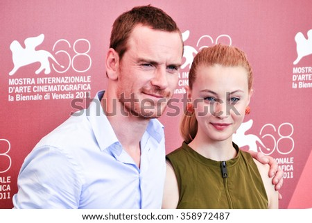 VENICE - SEPTEMBER 2: Actors Matt Damon and Sarah Gadon at photocall during the 68th Venice Film Festival at Palazzo del Cinema in Venice, September 2, 2011 in Venice, Italy. - stock photo