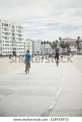 VENICE-SEPTEMBER 12:Bikers on Venice Beach Boardwalk on September 12,2015 in Venice,California.Venice Beach includes the Boardwalk,Muscle Beach,handball courts,paddle tennis courts,Skate Dancing plaza - stock photo