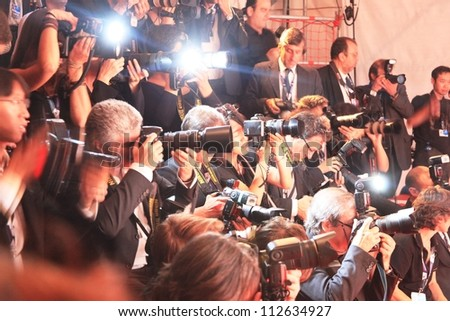 VENICE - SEPTEMBER 8: Photographers at work on the Red Carpet at 69th Venice Film Festival on September 8, 2012 in Venice, Italy. - stock photo