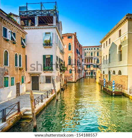 Venice sunset cityscape, Rio dei Greci water canal and traditional buildings. Italy, Europe. - stock photo