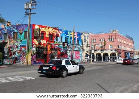 VENICE, UNITED STATES - APRIL 6, 2014: People visit Venice Beach, California. Venice Beach is one of most popular beaches of LA County. 9.8 million people live in LA County. - stock photo