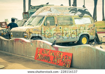 VENICE, UNITED STATES - DECEMBER 18, 2013: hippie artistic minivan on the Ocean Front Walk in Venice Beach near Santa Monica and Los Angeles. Vintage retro nostalgic filtered look and vignetting - stock photo