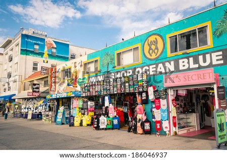 VENICE, UNITED STATES - DECEMBER 18, 2013: souvenirs shops on the Ocean Front Walk in Venice Beach. The area is a residential and recreational neighborhood in the Westside district of Los Angeles. - stock photo