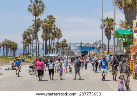 VENICE, UNITED STATES - MAY 21, 2015: Ocean Front Walk at Venice Beach, California. Venice Beach is one of most popular beaches of LA County. - stock photo