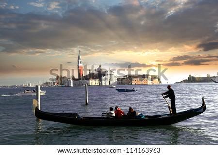 Venice with gondola against - stock photo