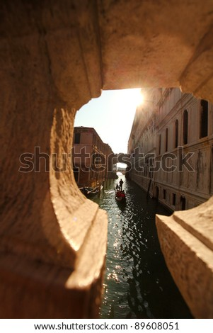 Venice with Gondolier on Canal, Italy - stock photo