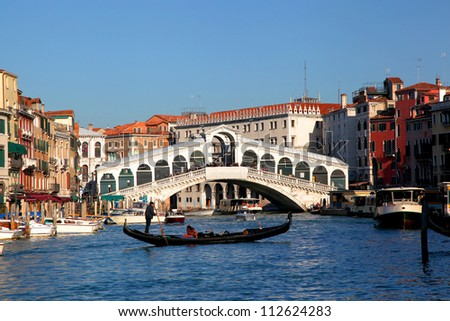 Venice with Rialto bridge and with gondola on Grand Canal, Italy - stock photo