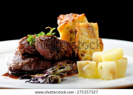 Venison meat steak with potato and vegetable - stock photo