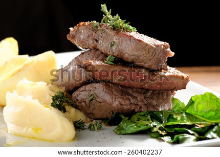 Venison meat steak with potato puree and vegetable - stock photo