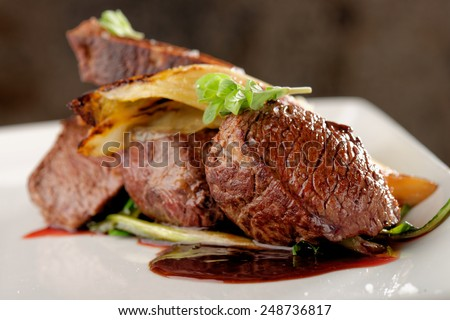 Venison meat steak with vegetable - stock photo