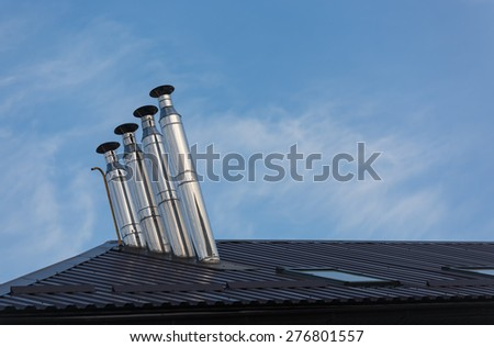 Ventilating pipes on a roof  - stock photo