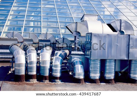 ventilation system on the roof. ventilation pipes on a background of a glass roof - stock photo