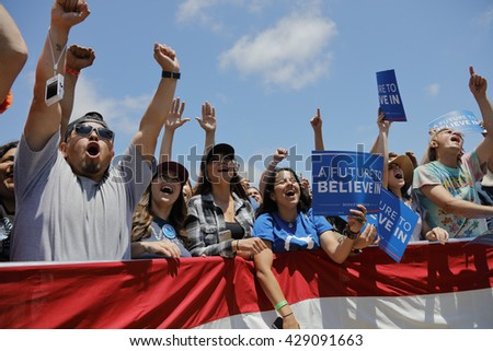 VENTURA, CA - MAY 26, 2016: Supporters of Senator Bernie Sanders hold signs at Presidential campaign rally at Ventura College, in preparation for June 7 California Primary Election.  - stock photo