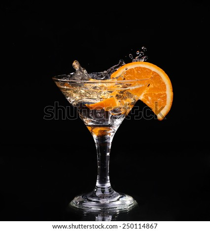 Vermouth cocktail inside martini glass over dark background - stock photo
