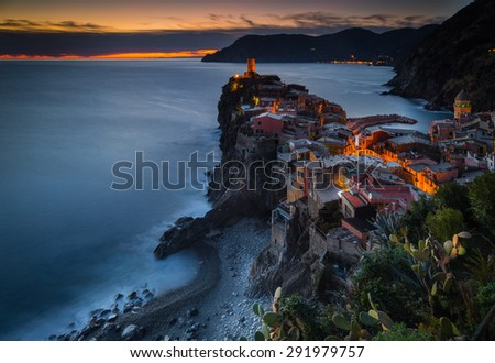 Vernazza, Liguria, Italy. The fishermen village during a cold blue hour in winter. - stock photo
