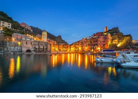 Vernazza town on the coast of Ligurian Sea at dusk, Italy - stock photo