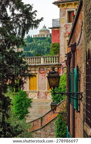 Verona Italy alley and Santuario Madonna di Lourdes - stock photo