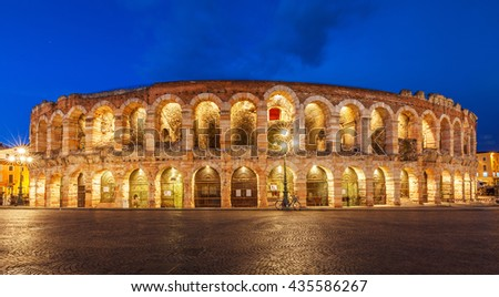 Verona, Italy. Ancient amphitheater Arena di Verona in Italy like Rome Coliseum with nighttime illumination and evening blue sky. Verona's italian famous ancient landmark theatre. Veneto region. - stock photo
