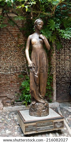 VERONA - ITALY JULY 11 2014: bronze statue of Juliet in Verona, Italy. It is one of the most visited sites in the town. - stock photo