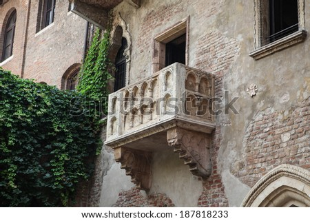 VERONA, ITALY � JULY 18, 2013: Famous balcony at the Juliet's House in Verona, the most popular attraction in the city, widely believed to be the place of Shakespeare's love tragedy Romeo and Juliet. - stock photo