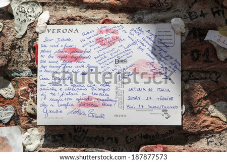VERONA, ITALY - JULY 18, 2013: Letter to Juliet, the female protagonist of Shakespeare's tragedy Romeo and Juliet, asking for love advice, stuck to the wall surrounding Juliet's House in Verona. - stock photo