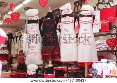 VERONA, ITALY - JULY 19, 2016 : Shop selling handmade aprons in Verona Square, Italy. Handmade aprons with personalized words on display at shop. Selective focus - stock photo
