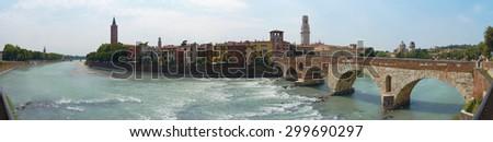 VERONA, ITALY - JULY 13: Stitched panorama of Verona showing Adige river and Pietra Bridge. July 13, 2015 in Verona. - stock photo