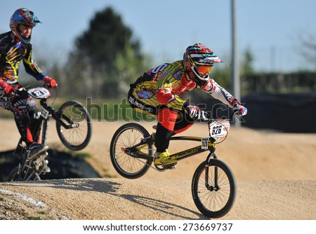 """VERONA, ITALY - MARCH 28: Unidentified BMX rider on March 28, 2015 in Verona, Italy. This competition included riders from many European countries at the """"BMX Olympic Arena"""" in Verona. - stock photo"""