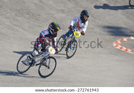 """VERONA, ITALY - MARCH 28: Unidentified child BMX rider on March 28, 2015 in Verona, Italy. This competition included young riders from many European countries at the """"BMX Olympic Arena"""" in Verona. - stock photo"""