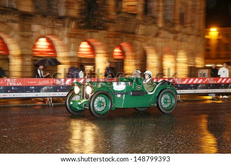 VERONA ITALY - MAY 16: Green (BRG) MG K3 Magnette, built in 1933, drives by the Arena during the 1000 Miglia historic car race, on May 16, 2013 in Verona - stock photo
