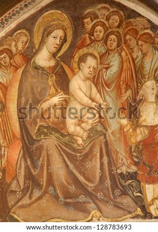 VERONA - JANUARY 27: Fresco of virgin Mary with the child from church Santa Anastasia on January 27, 2013 in Verona, Italy - stock photo
