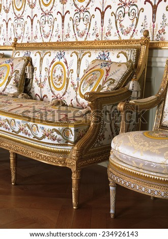Versailles, France - 10 August 2014 : Large armchair at Versailles Palace ( Chateau de Versailles ). It was added to the UNESCO list of World Heritage Sites.  - stock photo
