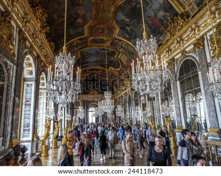 VERSAILLES, FRANCE - AUGUST 28 2013: Versailles, crowds of tourists visiting Palace of Versailles, Hall of Mirrors - stock photo