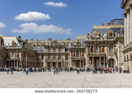 VERSAILLES, FRANCE - MAY 18, 2014: Architectural fragments of famous Versailles palace. The Palace of Versailles was a royal chateau. It was added to the UNESCO list of World Heritage Sites.  - stock photo