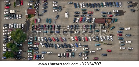 vertical aerial view over car parking place - stock photo