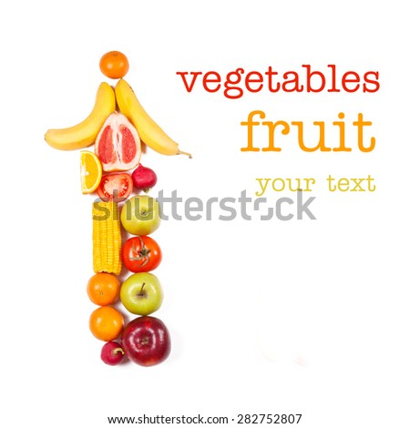 Vertical arrow from fruits and vegetables on a white background - stock photo