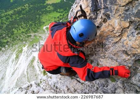 """Vertical climb on via ferrata """"Meisules"""", Sella massif, Dolomite Alps, Italy - stock photo"""