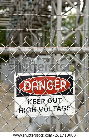 Vertical Danger, High Voltage, Keep Out Sign - stock photo