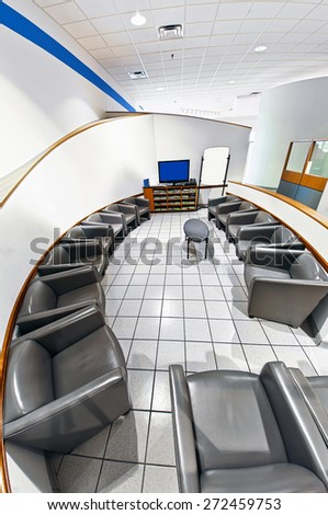 Vertical Fish Eye Shot Of Modern Waiting Room With Empty Chairs - stock photo