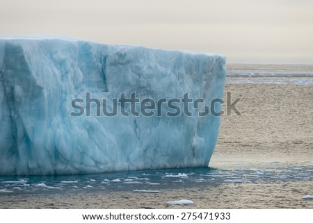 Vertical ice wall of an iceberg. Spitsbergen. - stock photo