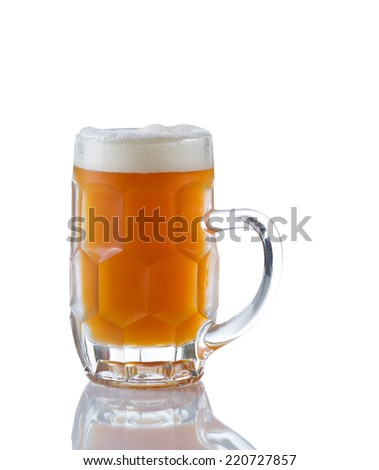 Vertical image of a Glass Stein filled with fresh amber beer on white with reflection - stock photo
