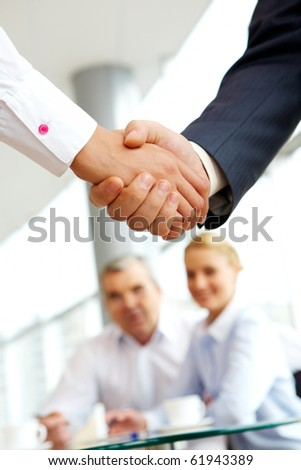 Vertical image of business agreement on the background of people - stock photo