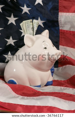 vertical image of piggy bank on an american flag - stock photo