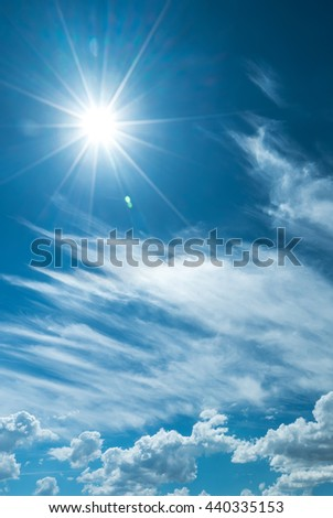 Vertical image of sky with clouds and shining sun - stock photo
