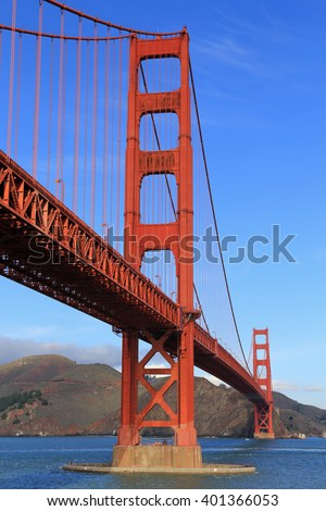 Vertical image of the Golden Gate Bridge on a clear sunny day. - stock photo